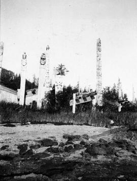 Totem poles at Tanoo, Queen Charlotte Islands; from the Department of Mines album, 1901, page 63,...