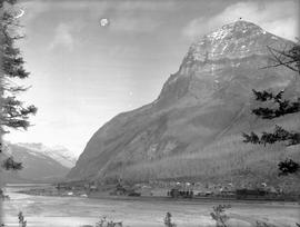 Cathedral Mountain above the settlement of Field; the Field Hotel and the Canadian Pacific Railway yards in the foreground.