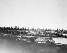 Looking east from the Songhees land; Victoria; the Johnson Street Bridge is at the left.