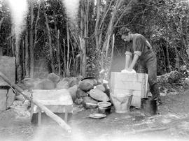 O'Meara preparing bread for baking at a survey camp in the Highland Valley.