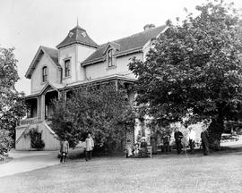 The Henry Rhodes residence, Blanshard Street, Victoria; family and servants on the lawn.