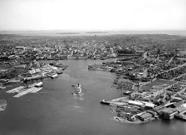 Aerial view of Victoria; fisherman's wharf at the right, Johnson Street Bridge centre left.