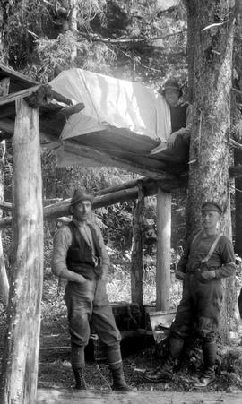 Survey crew constructing a cache at their camp at Kitlope Lake