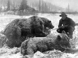 Bear hunter with killed animal, Revelstoke