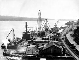 """Fleet laid up during high water""; construction of the Fraser River Bridge in New Westm..."
