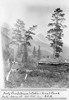 """Dirty Face Johnson's cabin; Lost Creek; photo taken at 9:00 p.m., Aug.; S.E.K."""