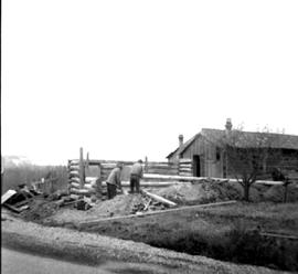 Fort Steele during restoration; rebuilding log cabin.