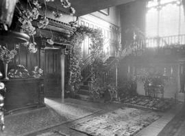 """Decorated for M. Woodburn's wedding, April 19""; the front hall of Schuhuum, the r..."
