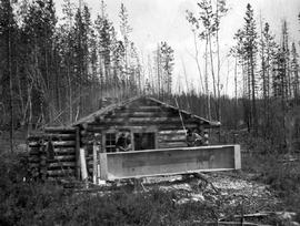 "Bureau of Mines survey crew building a flat bottomed boat at ""Irish's"" cabin at th..."