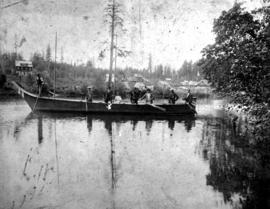 A group in a large boat on Long Lake, north of Wellington on Vancouver Island