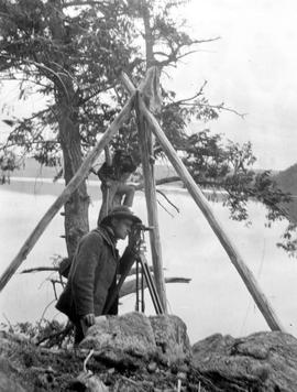 Surveyors taking sightings at Eyrie triangulation station on the shore of Fraser Lake.