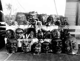 A collection of potlatch dancing masks.  Photo taken at Alert Bay, BC, Anglican Church parish hall.