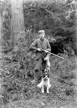 Alfred Robert Frewing, his dog and his catch for the day.