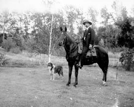 Bill Keny, his horse and his dog; Grand Forks.