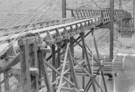 A wooden trestle bridge