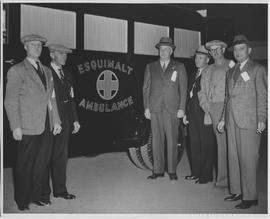 Reeve Lockley (centre), Fire Chief Pecknold (right), with splendid civil defence ambulance suppli...