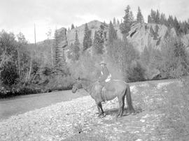 T. S. Gore on horseback at Sheep Creek.