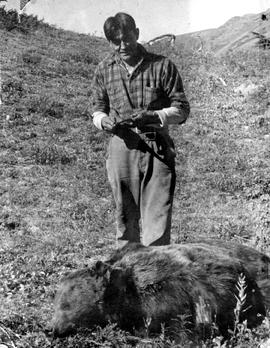 Benny Frank with silver tip grizzly, Telegraph Creek.