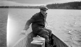 Charlie Musclow in the bow of a canoe