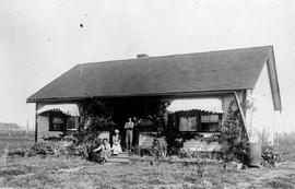 Settler E. J. Pearce's house at Merville after becoming established, Land Settlement Board.