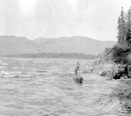 Alexander poling up the Finlay Rapids on the Peace River.