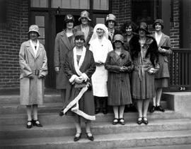 Chatelaine Lady Willingdon and unidentified women, including a nurse, on steps of a building at T...