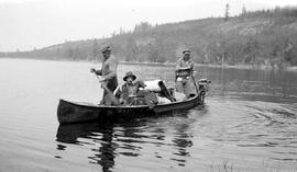 Canoe and crew, with their dog, Mike, on Intatah Lake.