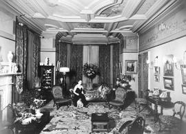 The second Mrs. Edgar Crow Baker, nee Clapham, in the drawing room of their residence, Sissinghur...