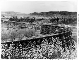 Trestle, Peace River, PGE double-diesel-headed passenger on spectacular combined steel and wooden...