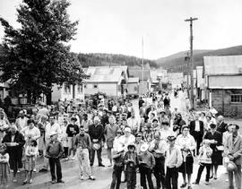Visitors standing in the street in front of St. Saviour's Church at the official opening of Barkerville as an historic site.