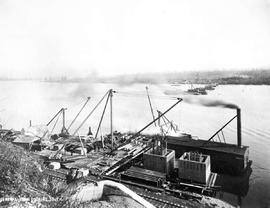"""General view, looking south""; construction of the Fraser River Bridge in New Westminster."