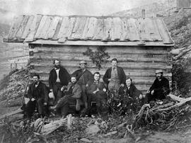 [Miners From Heron Claim, Heronville And Governor Seymour Seated Outside Building.  Governor Fred...