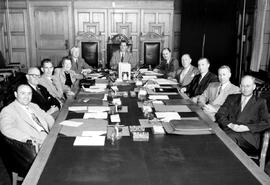 The Provincial Cabinet; left to right, Phil Gaglardi, William Ralph Chetwynd, William Kiernan, Tilly Rolston, Einar Gunderson, W.A.C. Bennett, Robert Bonner, Wesley Black, Robert Sommers, Lyle Wicks, Eric Martin