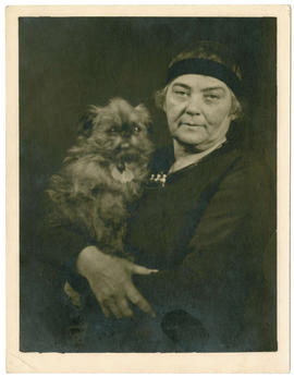 Emily Carr with her Brussels Griffon dog.