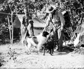 """Finlay River""; George V. Copley and Frank Swannell in camp with dogs."