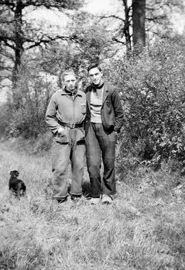 Two unidentified young men and a dog; from the Blenkinsop collection.