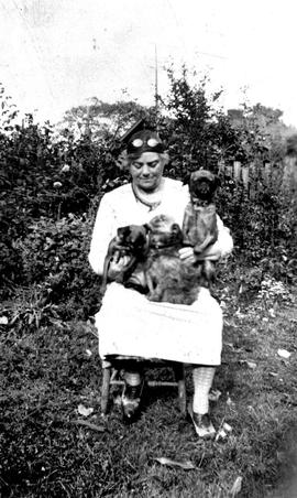 Emily Carr and her three dogs.