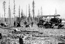 """Land clearing, tractor pulling stumps near Prince George"""