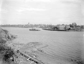 Victoria's Inner Harbour; tugboat rounding Laurel Point and the J. Sehl Furniture Furniture ...