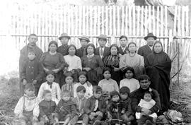 A group of indians at Alert Bay, BC.  Lower right is Charlie Wilson with a baby in his knee.
