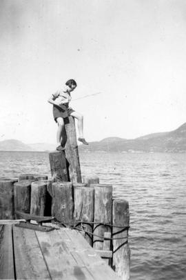 Marjorie fishing at the Big Wharf; Fintry on Okanagan Lake