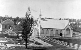 The Church of Our Lord, Victoria; corner of Blanshard and Humboldt Streets; Whitehorse Saloon in stone on left.