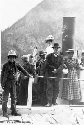 Group on Seton Lake; William Duguid in bowler hat and pale tie; Frank Swannell's wife, Ada, behind Duguid in large flowered hat.