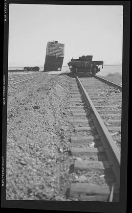 [Rail construction; toppled car]