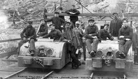 """Fernie Colliery disaster; motor cars and crew at entrance to No. 2; of these men, only four escaped death."""