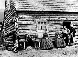 The Hamilton family at their ranch at Lightning Creek, Cariboo, from left to right; John Hamilton Jr., daughter Elizabeth Muir, Mrs. John Hamilton, John Hamilton Sr., unknown.