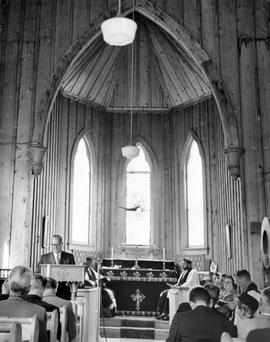 Premier W.A.C. Bennett reading at the church service at St. Saviour's Church; at the officia...