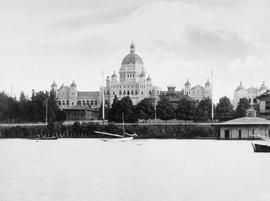 The new legislative buildings nearing completion; Birdcages still standing; Victoria.