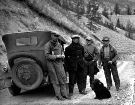 Survey crew on Sheep Creek trail; from left to right, driver T. Hodgson, George Powers, Captain Jones and Martin Ramsey.