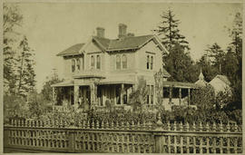 Carr residence with family on front porch, 207 Government St., Victoria; Mrs. Carr appears pregna...